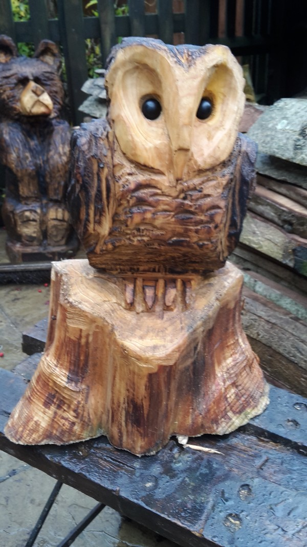 Chainsaw carving bob the gardener and tree surgeon